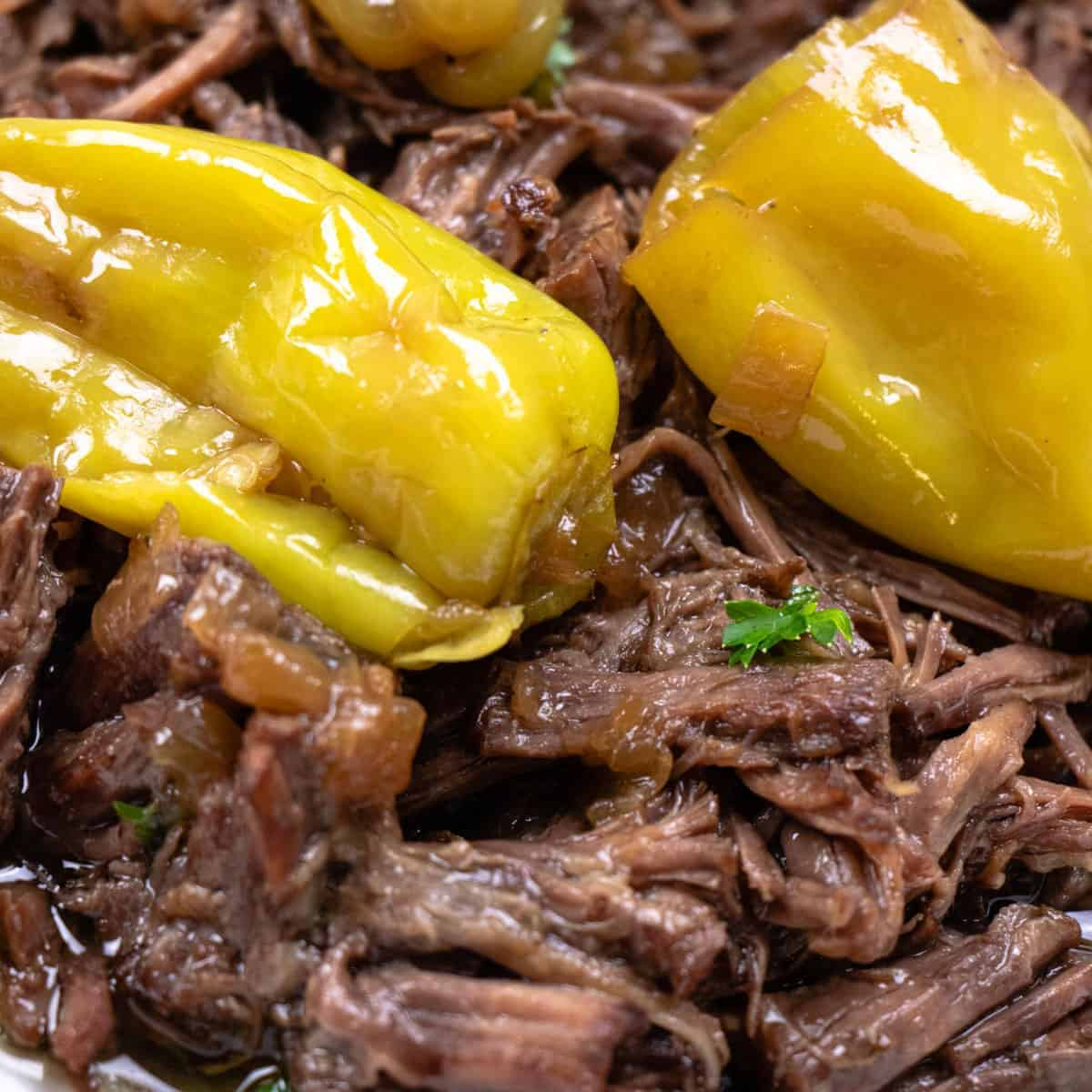Shredded beef with pepperoncini peppers on top