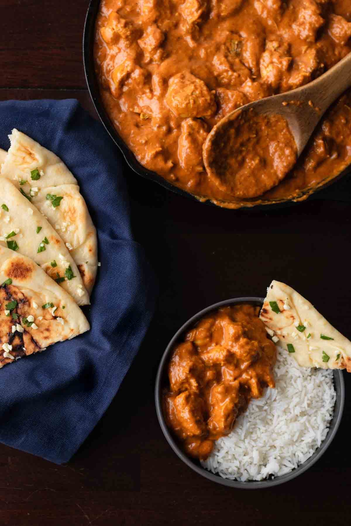 butter chicken served with rice and naan