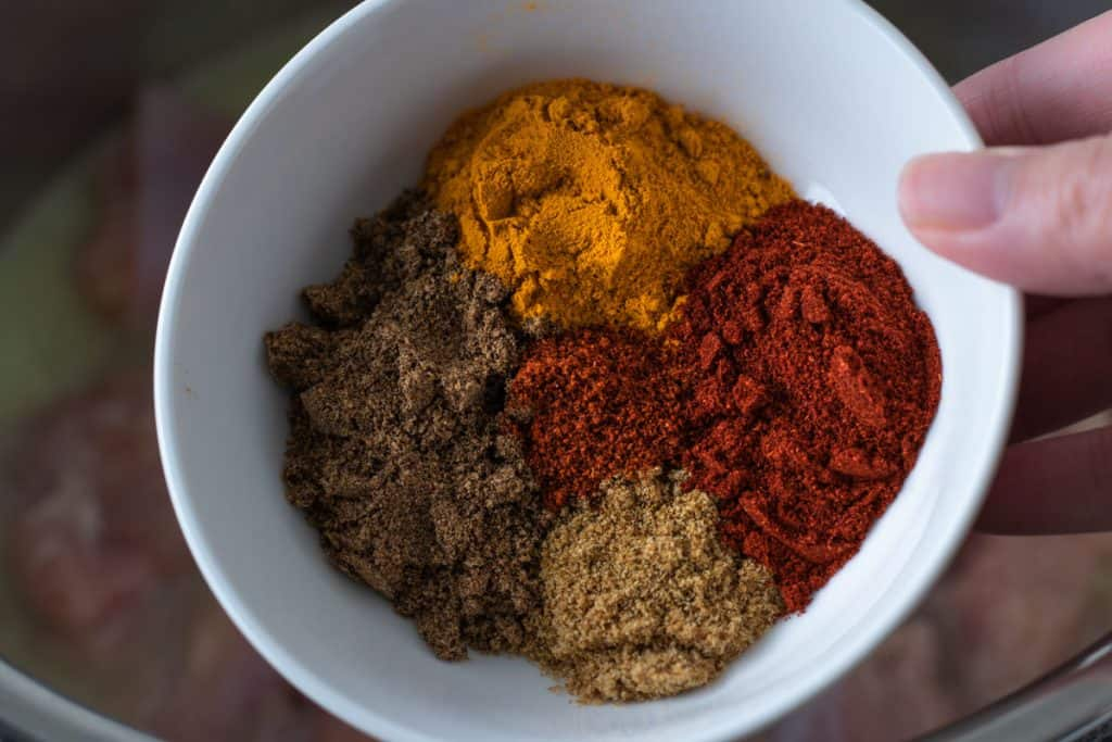 A blow of spices for butter chicken: cumin, garam masala, turmeric, smoked paprika, and cayenne