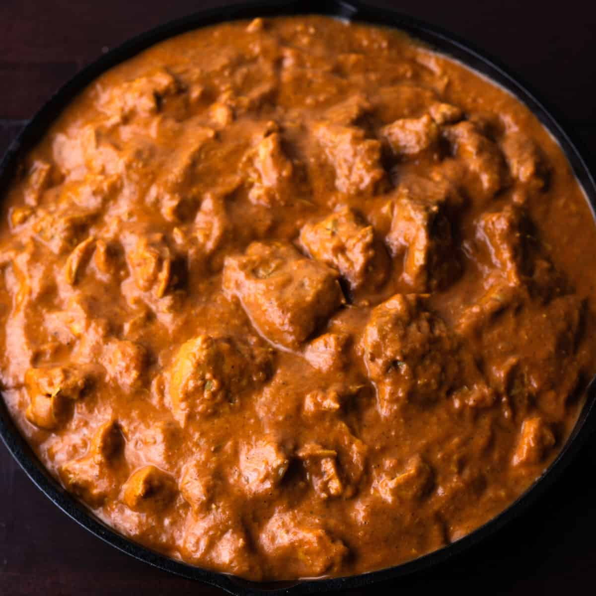 butter chicken in a black pan