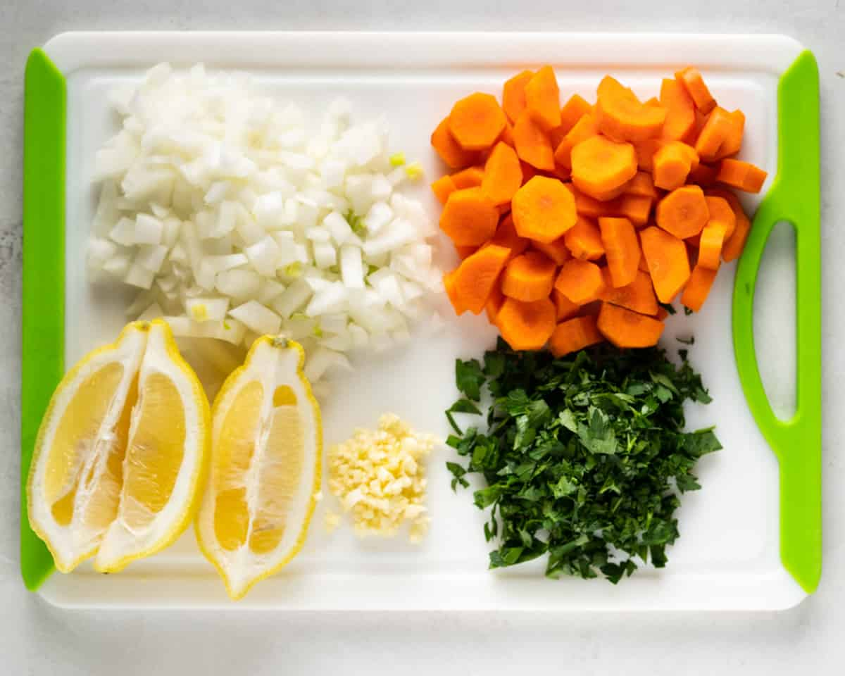 cutting board showing chopped vegetables needed for this soup