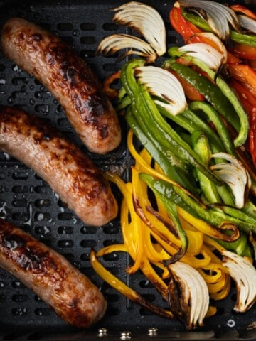 Cooked brats, peppers and onions in the air fryer