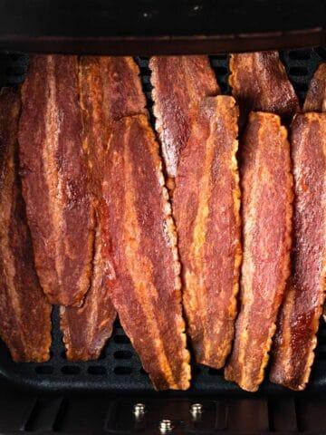 air fryer full of crispy turkey bacon